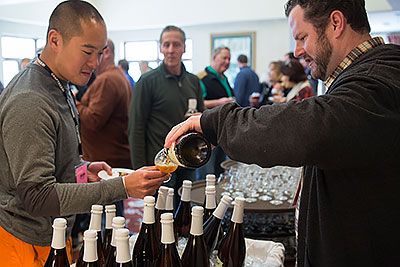 Patrick Pouring Beer for Tristan Chan